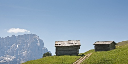 Hay huts idyll on a high-altitude alpine meadows in the Dolomites Stock Photo - 11761668