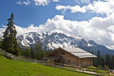 wooden hut: Wooden hut before the peaks of the Latemar in the Dolomites
