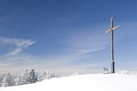 summit cross in winter