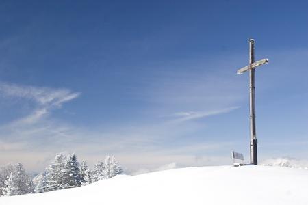 summit cross in winter