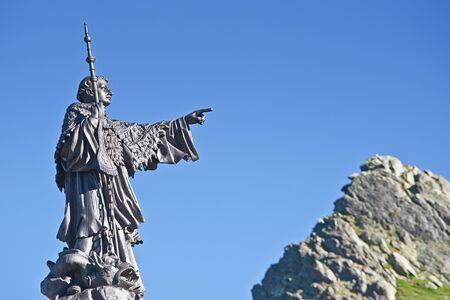 st bernard: he statue of St. Bernard at the pass of St. Bernard Pass Stock Photo