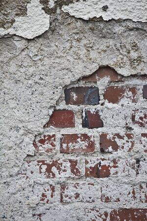 deficiencies: The ravages of time on this wall Stock Photo
