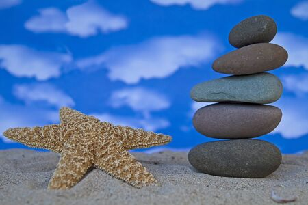 Stone tower with a starfish on the beach Stock Photo - 12307258