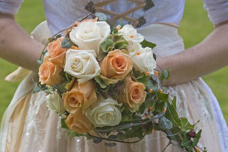 Bridal bouquet of white roses and tea-colored photo
