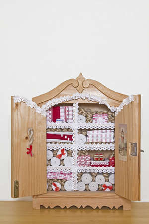 Dresser with bolts of cloth and flat braids photo