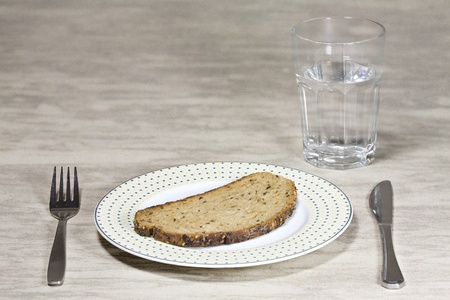 bad times: bad times - only water and bread Stock Photo