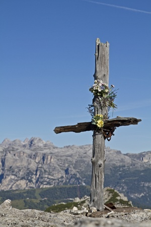 Small summit cross in Dolomites