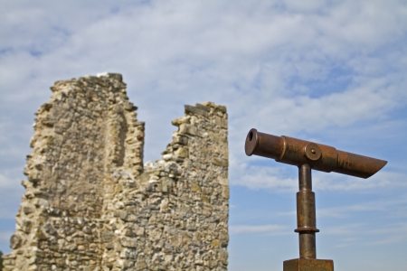 far sighted: Rustic telescope on ancient ruins Stock Photo