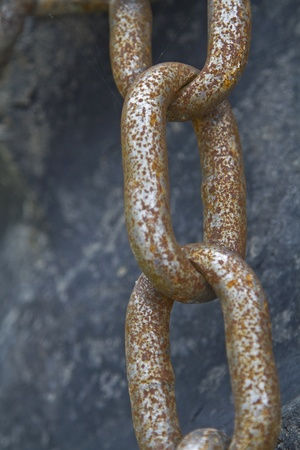 Detailed view of a thick rusty chain photo