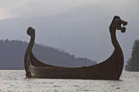 Viking ship in Walchensee against the light Stock Photo