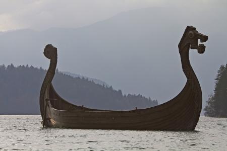 Viking ship in Walchensee against the light Standard-Bild