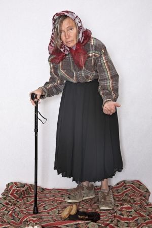 hartz 4: Poverty in old age - old woman begging for alms