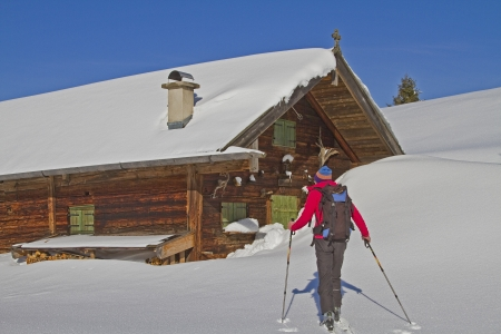curren: Ski tourers before idyllic pasture in Upper Bavaria Stock Photo