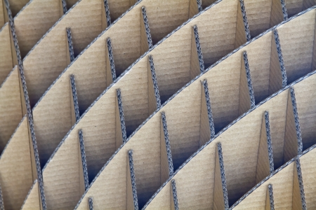 contiguous: Trapezoidal-shaped structural pattern from cardboard Stock Photo