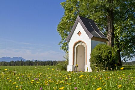 Small idyllic meadow chapel in Chiemgau Stock Photo - 15096886