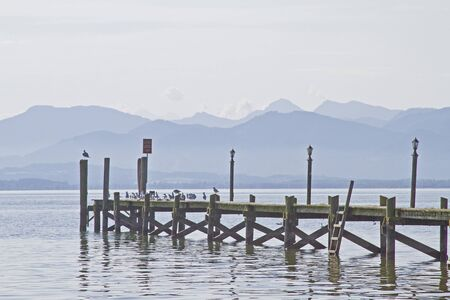 Wooden jetty on Lake Chiemsee is ideal for sunbathing and relaxing Stock Photo - 15298297