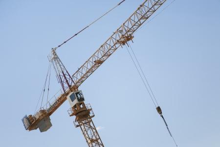 acrophobia: yellow construction  crane Stock Photo