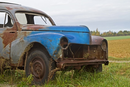 Forget and leave this disused car is on a dirt road photo
