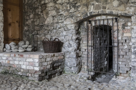 Barred door in old walls photo