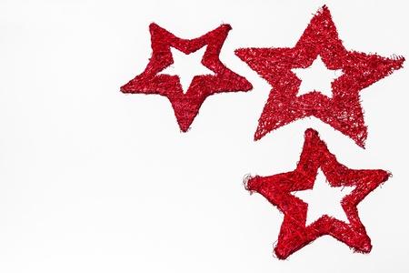 christmas motive: Red star trio on white background Stock Photo