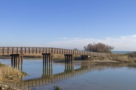 This bridge provides access to the Spiaggia di Boccasetta a sandy beach in the Po Delta Banco de Imagens - 19845650