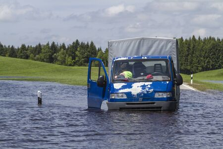 fails: Van fails when driving through a flooded section of road
