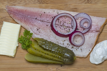 Smoked trout fillet on wooden sandwich board photo