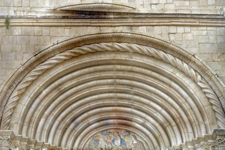 romanesque: Impressive Romanesque church portal in Sulmona Stock Photo