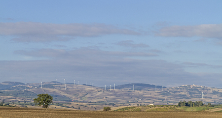 molise: Many windmills on the hills of the Apennines provide as here in the Molise region Energy Stock Photo