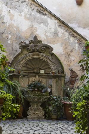 tuscania:  idyllic fountain in the center of Tuscania Stock Photo