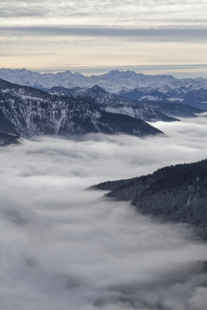 Inversion situation - view on the fog covered Spitzingsee and the Valley of Valepp Фото со стока