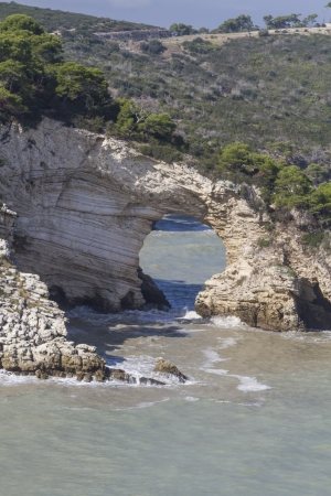 felice: Arco San Felice -  famous rock gate in Puglia Stock Photo