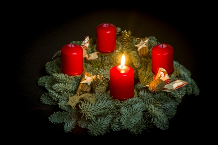 Advent wreath with of one burning candle Standard-Bild