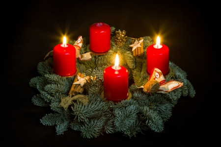Advent wreath with three burning candles Stock Photo
