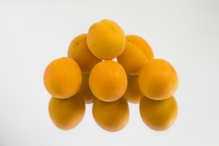 mirror image: Apricots with mirror image Stock Photo