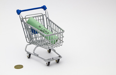 Miniature shopping cart with money roll photo