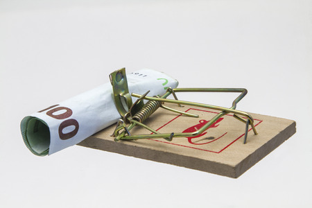 Primitive and powerful - Mousetrap and banknote on white background photo