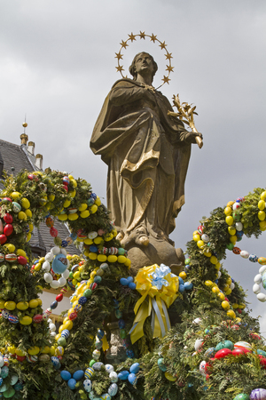 mother god: In glorious color, decorated Easter fountain in the town square in Prichsenstadt