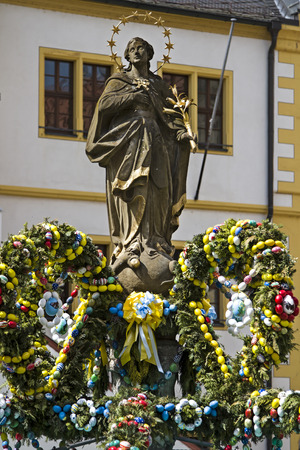 mother god: In glorious color, decorated Easter fountain in the town square in Volkach Stock Photo