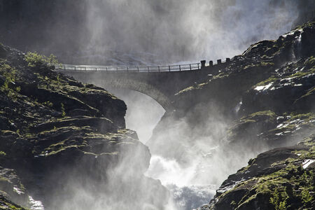 The 320 m high Stigfossen plunges spectacularly beside the Trollstigen Pass road in the depth photo