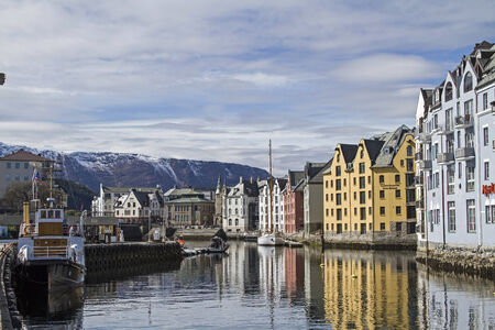 alesund: Colorful storage houses lining the banks in the charming city of Alesund in Norway