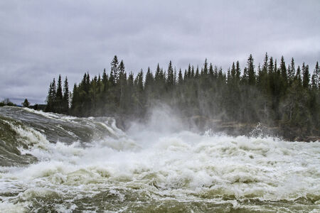 Besides the E 6  the wild river thunders with a roar into the valley photo