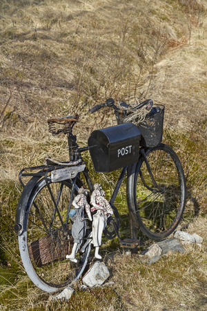 original bike: An original letter box in front of a house in northern Norway Stock Photo