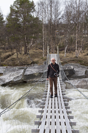 rickety: The exceeding of a wild river on a rickety suspension bridge requires a lot of courage