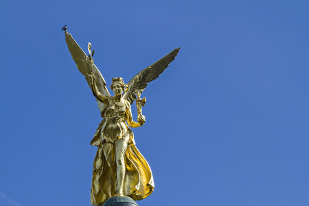 prince of peace: The Angel of Peace, a memorial in Munich is golden and six meters high and is located on a column in Corinthian style Stock Photo