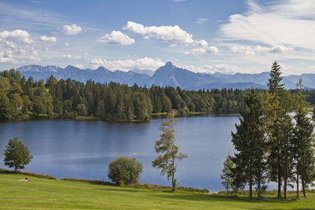 The Schwalten pond in allgaeu is an idyllic lake which is used today as a bathing lake and fish farming