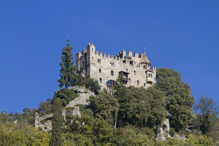 meran: castle Brunnenburg near Meran in South Tyrol, was rebuilt in 1900 on the remains of a ruined medieval building in the historic style.