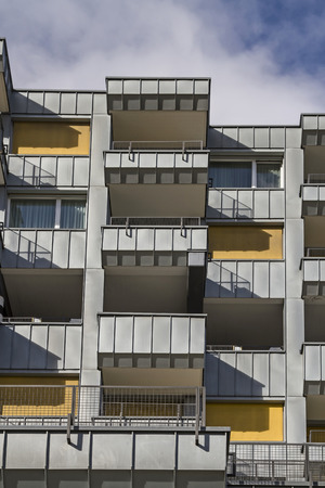 swanky: Next to swanky hotels shape the image of St. Moritz modern commercial buildings and apartment houses Stock Photo