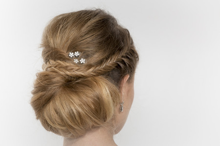 updo: Hair of a young bride