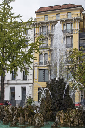 characterize: Magnificent office buildings and bank buildings. Fountains and avenues characterize the city of Lugano in Switzerland